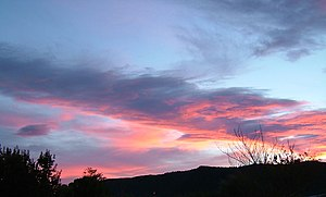 Photo of a sunset over the hills to the south of Waimate, taken from near the town centre.