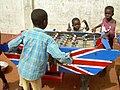 Supporting Soccer Aid Ghanaian children playing table football (7267148732).jpg