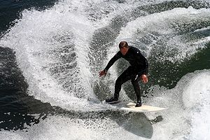 A California surfer. The surfer is performing ...