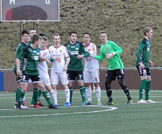 Tvøroyrar Bóltfelag - TB/FC Suðuroy/Royn in green playing their first match in Effodeildin in March 2017.