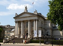 exterior of neo-classical public building with columns and portico