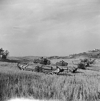 51st (Leeds Rifles) Royal Tank Regiment - Churchill tanks of 51 RTR lined up below a crest near the River Foglia, 30 August 1944. The tanks were supporting infantry of the 139th Brigade attacking across the river.