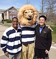 The College of New Jersey mascot with two student welcoming volunteers.JPG