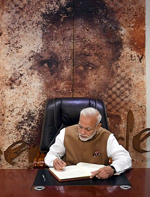 The Prime Minister, Shri Narendra Modi signing the visitors' book, during his visit to the Kigali Genocide Memorial Centre, in Rwanda on July 24, 2018.JPG