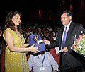 The Secretary, Ministry of Information and Broadcasting, Shri Uday Kumar Verma presenting a memento to Bollywood Actress, Madhuri Dixit.jpg