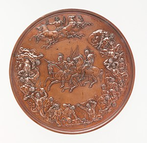 A bronze medal, with allegorical figures surrounding two equestrian figures in the centre