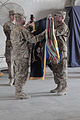 The commander and command sergeant major of the U.S. Army's 4th Brigade Combat Team, 101st Airborne Division uncase the colors at Forward Operating Base Salerno in Khost province, Afghanistan, May 22, 2013 130522-A-CW939-060.jpg