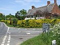Timbered Thatched House at Crossroads - geograph.org.uk - 439952.jpg
