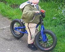 50bd56678cf Toddler on metal balance bike