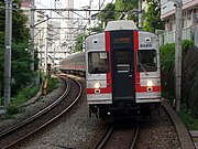 Tōkyū 8000 series train approaching Daikanyama Station.This color scheme is called Kabuki.