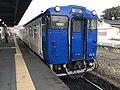 Train of Kashii Line arriving at Umi Station.jpg