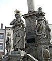 Trutnov (okr. Trutnov), sloup se sousoším Nejsvětější Trojice, detail soch u podstavce.JPG