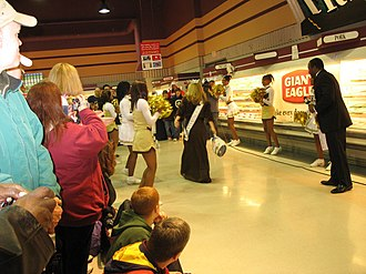 Turkey bowling -  Miss Ohio 2006 bowls a turkey in Willowick, Ohio