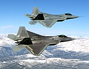 "Two F-22s, the upper one being the first EMD F-22, ""Raptor 01"""