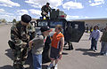 U.S. Air Force Airman 1st Class Marc Lorance handcuffs a student at West Elementary School in Great Falls, Mont., during a demonstration by the 341st Security Forces Group May 12, 2006 060512-F-KU527-085.jpg