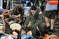 U.S. Air Force Senior Airman Milyn Kane, standing center, a medical technician with the 139th Aeromedical Evacuation Squadron, New York Air National Guard, secures a simulated patient for airlift in the cargo 130601-Z-GJ424-029.jpg