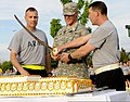 U.S. Army Col.(P) John Thomson, deputy commander of the 4th Infantry Division and Fort Carson, and Command Sgt. Maj. Brian M. Stall, senior enlisted adviser, cut a cake in celebration of the Army's 238th 130613-A-UK001-002.jpg