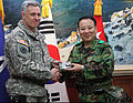 U.S. Army Lt. Gen. John Johnson, left, the commanding general of the Eighth U.S. Army, gives the gift of a coin to South Korean army Gen. Lee Chul-hyee, the commanding general of the 2nd Operational Command 110309-A-AP548-033.jpg