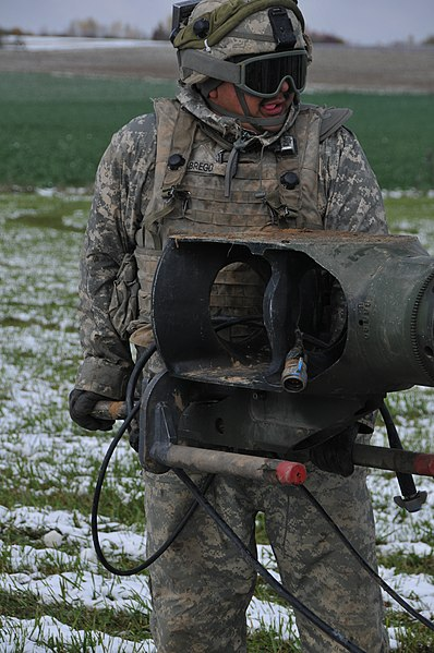 File:U.S. Army Pfc. Jose Abrego, with Alpha Battery, Field Artillery Squadron, 2nd Cavalry Regiment, lifts an end of an M777 155 mm howitzer during a decisive action training environment exercise at the Joint 121028-A-TF309-004.jpg