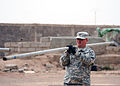 U.S. Army Sgt. Timothy Vandruff, with 2nd Battalion, 137th Infantry Regiment, Kansas National Guard, moves a fence post at the police academy in Djibouti Sept 100901-N-AT895-085.jpg