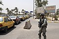 U.S. Army Spc. Otis Schrodt provides security during a combined combat patrol with the 1st Iraqi Federal Police Division at Joint Security Station Loyalty, Iraq, Aug 110805-A-RC236-005.jpg