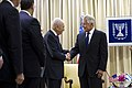 U.S. Defense Secretary Chuck Hagel, left, shakes hands with Israeli President Shimon Peres in Jerusalem May 16, 2014 140516-D-BW835-230.jpg
