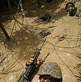 U.S. Marine Corps Pfc. Ross Simpson, with 7th Communications Battalion, advances through an obstacle course at the Jungle Warfare Training Center (JWTC) on Camp Gonsalves, Okinawa, Japan, Aug. 21, 2009 090821-M-WA483-233.jpg