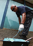U.S. Navy Hospital Corpsman 1st Class Ritchie Luna, embarked aboard amphibious assault ship USS Iwo Jima (LHD-7), paints a school in Limon, Costa Rica, Aug. 23, 2010, during Continuing Promise 2010 100823-M-PC721-452.jpg