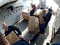 U.S. Sailors aboard the guided missile destroyer USS Ramage (DDG 61) move supplies during a replenishment at sea in the Mediterranean Sea Feb. 22, 2014 140222-N-CH661-202.jpg