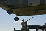 U.S. Soldiers with the 390th Seaport Operations Company (SPOC) connect the reach pendants from a sling-loaded Humvee onto a CH-47 Chinook helicopter during sling load operations at Joint Expeditionary Base 130804-A-GT254-012.jpg