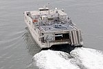 USNS Spearhead with helicopter during sea trials.jpg