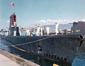 USS Carbonero (SS-337) about to tie up inboard of the Gudgeon (SS-567) at Pearl Harbor, c. 1963.