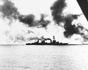 USS Salt Lake City (CA-25) - Salt Lake City, damaged by Japanese cruiser gunfire, starts losing speed prior to going dead in the water during the battle under a smoke screen laid by accompanying destroyers.
