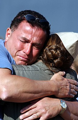 US Navy 020620-N-1110A-503 Father hugs daughter goodbye before deployment