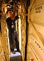 US Navy 030303-N-3235P-504 Gunner's Mate 2nd Class Justin S. Burt, assigned to the weapons department's WF-01 division, inspects a deluge hose for water leaks below decks.jpg