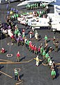 US Navy 030625-N-0119G-001 Sailors aboard USS Enterprise (CVN 65) assigned to the air department and Carrier Air Wing One (CVW-1) form a human chain.jpg