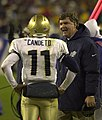 US Navy 031206-N-9693M-512 Navy head coach Paul Johnson talks to quarterback Craig Candeto between plays during the 104th Army Navy Game.jpg