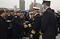 US Navy 040224-N-3931M-126 Rear Adm. Xu Jiwen, commander of Shanghai Naval Base, center left, greets Vice Adm. Robert Willard, Commander U.S. Seventh Fleet.jpg