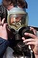 US Navy 040423-N-9851B-005 Seaman Justin Harrison operates a sound powered phone while wearing an MCU-2P gasmask.jpg