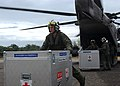US Navy 050108-N-4451V-007 Cpl. Ian Ballentyne offloads medical supplies from a CH-53E Super Stallion helicopter at Muebaloh City Air Field.jpg