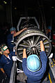 US Navy 050203-N-9273C-011 Sailors, assigned to IM-2 Division, Aviation Intermediate Maintenance Department (AIMD), install a fan module onto a F414 jet engine.jpg