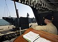 US Navy 050309-N-3241H-039 Executive Officer, USS Carl Vinson (CVN 70), Capt. DeWolfe Miller, supervises from the Quarterdeck, the raising of the brow as the Nimitz-class aircraft carrier USS Carl Vinson (CVN 70) prepares to de.jpg