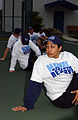 US Navy 050328-N-8500S-001 Petty Officer 2nd Class Shawna Moore, foreground, and other 2005 Navy Reserve Sailor of the Year finalists stretch during physical training.jpg