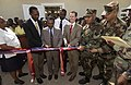 US Navy 050505-N-3642E-016 Mr. Pierre Buteau, left, Mr. Douglas Griffiths, center, and Rear Adm. Vinson Smith, cut a ribbon celebrating the completion of a classroom.jpg