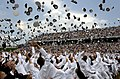 US Navy 050527-N-6077T-018 Newly commissioned officers celebrate their new positions by throwing their Midshipmen covers into the air as part of the U.S. Naval Academy class of 2005 graduation and commissioning ceremony.jpg