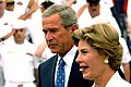 US Navy 050830-N-5549O-024 President George W. Bush and First Lady Laura Bush walk past a crowd of Sailors prior to delivering a speech in commemoration of the 60th anniversary of the victory over Japan (VJ Day) during World Wa.jpg