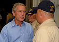 US Navy 050915-N-5345W-141 U.S. President George W. Bush speaks with the Command Master-At-Arms, Senior Chief David Allen on the quarterdeck after returning to the amphibious assault ship USS Iwo Jima (LHD 7) following a live a.jpg