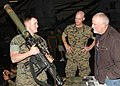 US Navy 060214-N-7217H-014 Cpl. Stephen Bray, assigned to the 13th Marine Expeditionary Unit (13th MEU), BLT Golf Company, explains the purpose of the MK-153 Shoulder Launched Multi Purpose Assault Weapon (SMAW) to Tiger Cruise.jpg