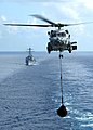 US Navy 060413-N-9898L-044 An SH-60B Seahawk helicopter assigned to the Saberhawks Helicopter Squadron Light Four Seven (HSL-47), conducts a vertical replenishment (VERTREP).jpg