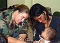 US Navy 060528-N-8391L-099 U.S. Air Force Staff Sgt. Stacy Carmichael evaluates a patient as part of a medical assistance mission.jpg